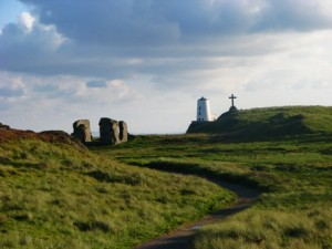 Llanddwyn lighthouse, church and Celtic cross
